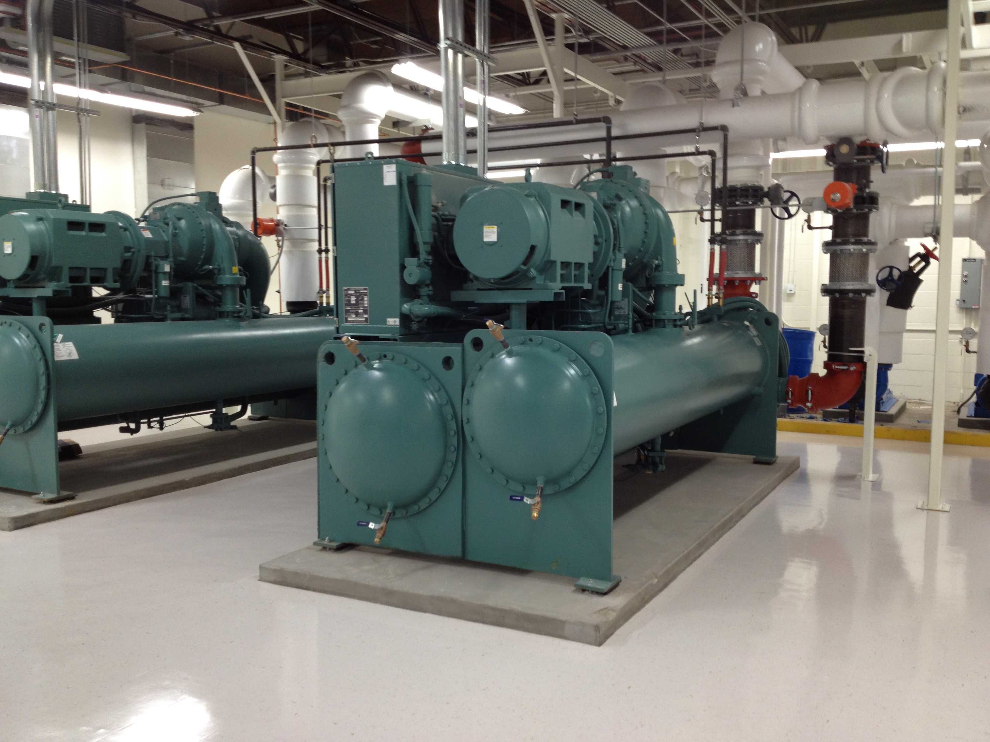 Chillers moreover In Row Cooling likewise Cogeneration Presentation besides Apc Rack Cooling besides Air Handling Units. on heat and cooling units
